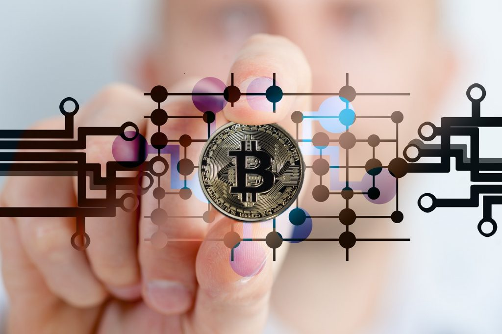 A hand and Bitcoin
